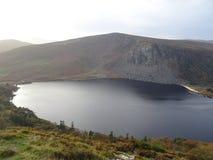 Irish Guinness Lake Lough Tay in the Wicklow Mountains. Famous Irish Guinness Lake Lough Tay in the Wicklow Mountains royalty free stock photography