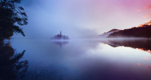 Famous island with old church in the city of Bled Stock Photos