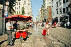 Famous Istiklal street with tourists and traditional sellers of hot chestnuts Stock Images