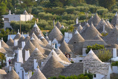 Famous Italian landmark, trulli of Alberobello, Apulian region,. View of Alberobello with trulli roofs and terraces, Apulia region, Southern Italy. Famous Stock Image