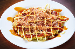 Okonomiyaki. The famous japanese dish called Okonomiyaki Stock Images