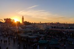 Jemaa el-Fna Square at night. The famous Jemaa el-Fna square and marketplace during a beautiful sunset with the Koutoubia mosque in the background stock photos