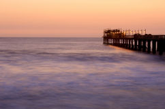 Famous jetty in Swakopmund, northwestern Namibia Stock Photos