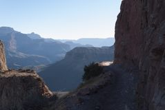 Kaibab trail, Grand Canyon, Arizona,USA. Famous Kaibab trail to the floor of Grand Canyon, Arizona. Early morning. Peaks of mountains and hiking trail. Down the Stock Photos