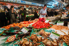 Famous La Boqueria market with seafood in Barcelona. BARCELONA, SPAIN - OCTOBER 23,2015: Famous La Boqueria market with seafood and unidentified people. One of royalty free stock image