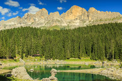 Famous lake of Carezza and Dolomites in background,Italy Royalty Free Stock Images