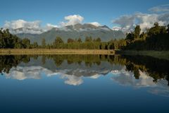 Famous Lake Matheson awesome reflection of Mount Cook royalty free stock photography