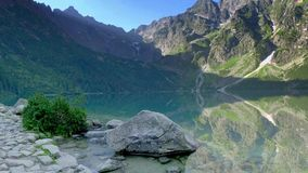 Famous lake in the middle of the Tatras mountains at dawn, Poland stock video footage