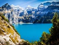 Switzerland view of lake Oeschinen, Oeschinensee, in Kandersteg Stock Images