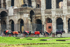 Famous landmark Colosseum in background and carriage in foregrou. Rome, Italy - December 12, 2016: Famous landmark Colosseum in background and carriage in Stock Images