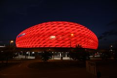 Red Allianz Arena. Famous landmark, exterior of the Allianz Arena in Munich, Germany. Night shot, the arena lit with red light, night sky as space for text, copy royalty free stock photos