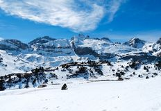 Famous landscape of spanish pyrenees mountains called candanchu full of white snow in a winter day with a clear blue day with a. Cloud. horizontal photo stock images