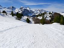 famous landscape of spanish pyrenees mountains called candanchu full of white snow in a winter day with a clear blue day with a royalty free stock images