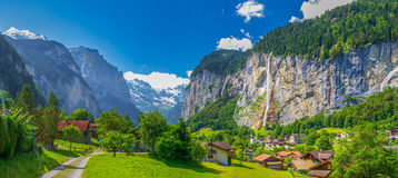 Famous Lauterbrunnen valley with gorgeous waterfall and Swiss Alps Stock Images