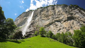 Famous Lauterbrunnen valley with gorgeous waterfall and Swiss Alps in the background, Switzerland, Europe. stock video