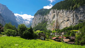 Famous Lauterbrunnen valley with gorgeous waterfall and Swiss Alps in the background, Switzerland, Europe. stock video footage