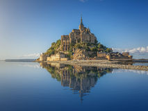 Famous Le Mont Saint-Michel, Normandy, France. Beautiful panoramic view of famous Le Mont Saint-Michel tidal island on a sunny day with blue sky and clouds in Royalty Free Stock Photo