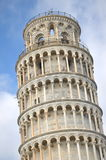 The famous Leaning Tower in the clouds on Square of Miracles in Pisa, Tuscany, Italy Royalty Free Stock Photo