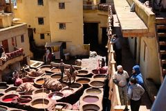 Famous Leather dye house and several workers working under the sunshine in Fez, Morocco stock photography