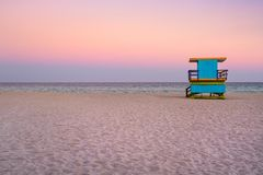 Lifeguard tower at South Beach in Miami with a beautiful sunset sky stock image
