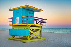 Famous lifeguard tower at South Beach in Miami with a beautiful sunset sky stock images