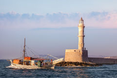 Famous lighthouse in Chania and pleasure boat, Greece Royalty Free Stock Photography