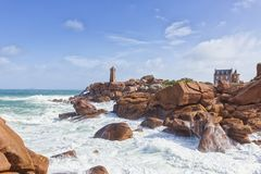 Ploumanach Mean Ruz lighthouse at Pink Granite Coast,Brittany, Fr. Famous lighthouse of Ploumanach and Maison Gustave Eiffel at the Cote de granite rose Royalty Free Stock Images