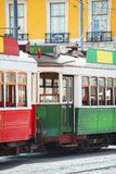 Famous Lisbon trams. Famous Lisbon trams on the street Royalty Free Stock Photography