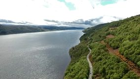 The famous Loch Ness aerial shot green Scotland United Kingdom stock footage