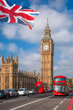 London with red buses against Big Ben in England, UK. Famous London with red buses against Big Ben in England, UK Stock Photos