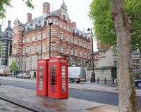 Famous London Red Phone Booth. The famous London red phone booth along road by River Thames in London, England Royalty Free Stock Images