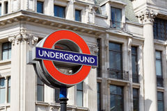 Famous London underground sign with architecture background Royalty Free Stock Photos