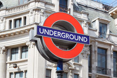 Famous London underground sign with white architecture Stock Photography