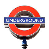Famous London underground sign on white. LONDON - AUGUST 6, 2015: Famous London underground sign isolated on white, clipping path included. The tube logo was Stock Photo