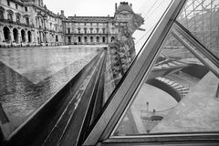 Famous Louvre museum. And its reflection Stock Photo