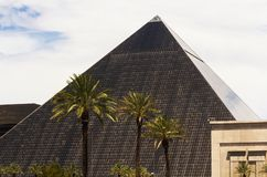 Famous Luxor hotel in Las Vegas. Las Vegas, NV, USA - July 2013: The pyramid shaped Luxor Hotel and Casino on Las Vegas strip royalty free stock image