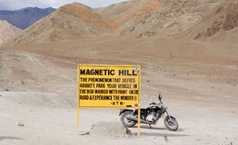 The famous Magnetic Hills on the outskirts of Leh. A signboard on the outskirts of Leh indicating the famous Magnetic Hills where the gravity is defied Stock Image