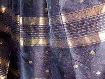 Famous Maheshwari Sarees with Golden Work-India. Blue color saree or sari with golden work on it stock image
