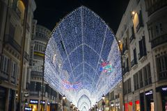 The famous main street of Malaga - the Marquis de Larios at night. Bright lighting, garlands and lights on a pedestrian street. royalty free stock image