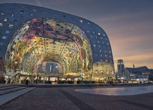 Markthal Rotterdam illuminated during a nice blue hour. The famous Markthal designed by MVRDV and painted ceiling by Joe Coenen after sunset. A beautiful soft stock photography