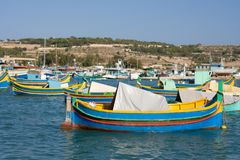 Colorful Boats In Harbor, Malta. The famous Marsaxlokk harbor in Malta with the Luzzu boats Stock Photography