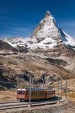 Matterhorn peak with Gornergrat train in Zermatt area, Switzerland. Famous Matterhorn peak with Gornergrat train in Zermatt area, Switzerland stock image