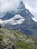 Famous Matterhorn in Swiss canton. Valais in clouds Stock Photos