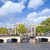 Famous Meager Bridge in Amsterdam canal belt, Netherlands. AMSTERDAM-AUG. 19, 2012. The famous Meager Bridge in canal belt. Amsterdam is known as Venice of the Royalty Free Stock Photography