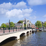 Famous Meager Bridge in Amsterdam canal belt, Netherlands. AMSTERDAM-AUG. 19. 2012. Famous Magere Brug over the river Amstel in historical canal belt. Because Stock Photos
