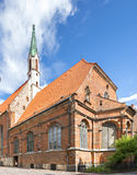 Famous medieval church of St John in old city of Riga, Latvia, Europe Stock Photos