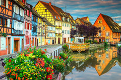 Famous medieval half-timbered facades reflecting in water, Colmar, France. Amazing colorful traditional french houses on the side of river Lauch in Petite Venise Royalty Free Stock Image