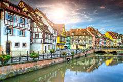 Famous medieval half-timbered facades reflecting in water, Colmar, France. Spectacular colorful traditional french houses on the side of river Lauch in Petite Stock Photo