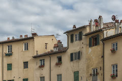 The famous medieval square known as Piazza Amphitheater in Lucca. Lucca Tuscany, Italy, the famous medieval square known as Piazza Amphitheater Royalty Free Stock Image