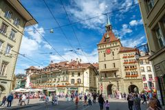 The famous medieval tower called the Kafigturm in Bern, Switzerland. Bern, Switzerland - September 16, 2015: Photo taken in the Spitalgasse in Bern, looking royalty free stock photo